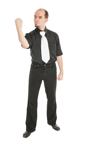 Angry man threaten with his fist isolated on white