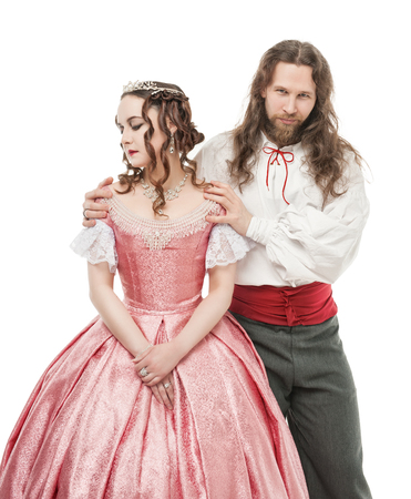Beautiful couple woman and man in medieval clothes isolated Stock Photo