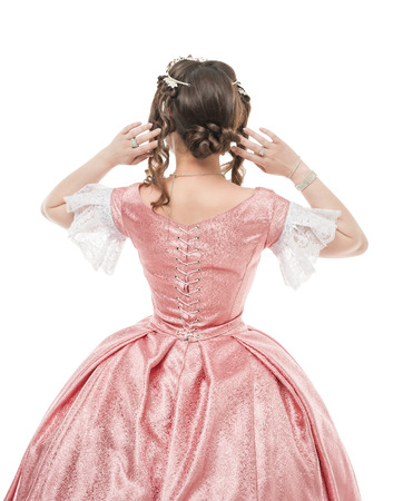 ruche: Beautiful woman in old historic medieval dress isolated. Back pose