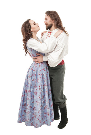 Beautiful couple woman and man in medieval clothes isolated on white Stock Photo
