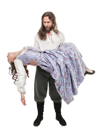Handsome man in medieval costume holding beautiful woman on his hands isolated