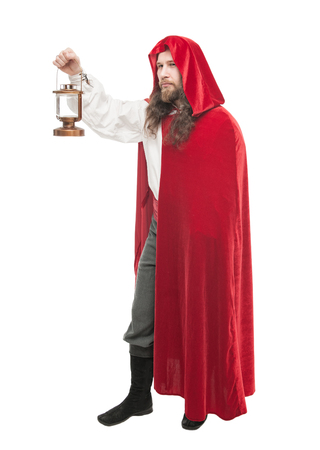 pilgrim costume: Medieval man in cape with lamp isolated on white