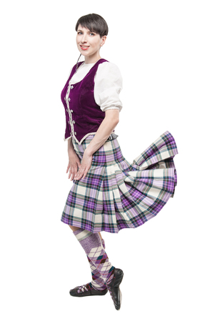 Young woman in clothing for Scottish dance isolated