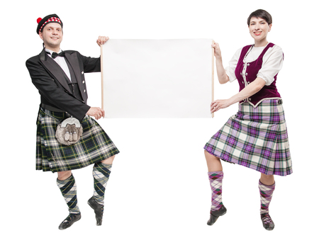 Pair of dancers of Scottish dance with empty banner isolated