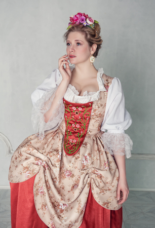 ruche: Sad beautiful woman in old-fashioned historic medieval dress