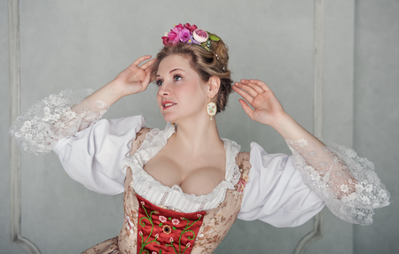 Beautiful woman in old-fashioned historic medieval dress
