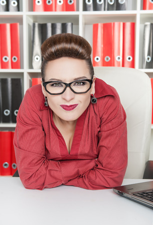 Angry displeased business woman with glasses in office photo