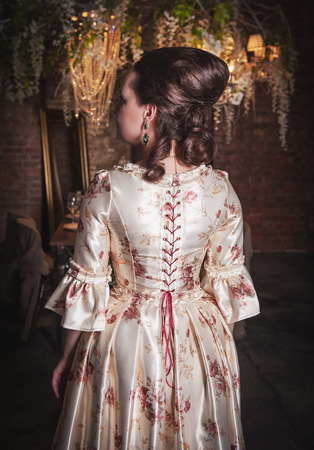ruche: Beautiful woman in old historic medieval dress. Back pose Stock Photo