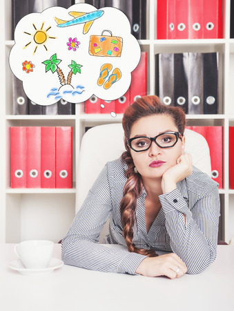 slog: Bored business woman dreaming about holiday in office. Overwork concept