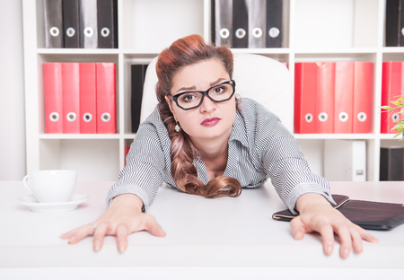 slog: Tired business woman working in office. Overwork concept