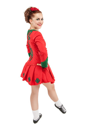 Beautiful woman in red dress for Irish dance isolated on white Stock Photo