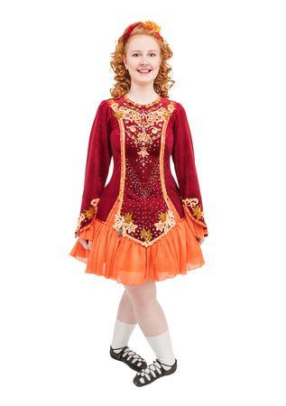 red clover: Beautiful woman in red dress for Irish dance isolated on white Stock Photo