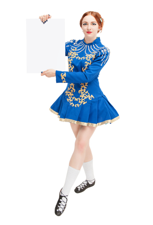 red clover: Beautiful woman in costume for irish dance with empty banner isolated Stock Photo