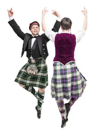 The pair woman and man dancing Scottish dance isolated Reklamní fotografie