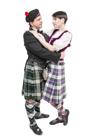 The pair woman and man in traditioanl Scottish costume isolated