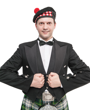 Handsome man in traditioanl Scottish costume isolated