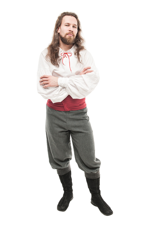 reenactment: Handsome man in historical pirate costume isolated on white
