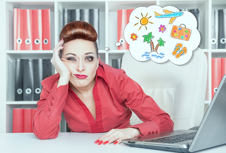 slog: Tired bored businesswoman dreaming about holiday in office. Overwork concept