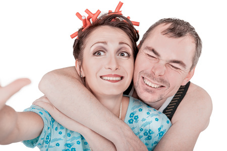 Funny retro couple taking photo of themselves selfie isolated on white Stock Photo