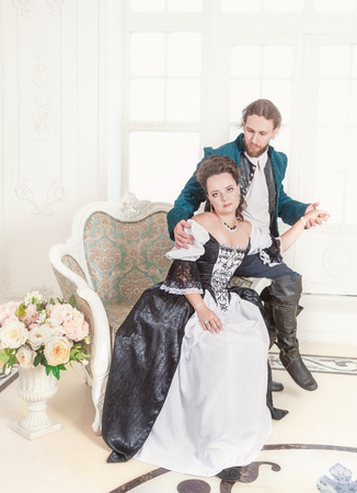 Beautiful couple woman and man in medieval clothes in the room Stockfoto