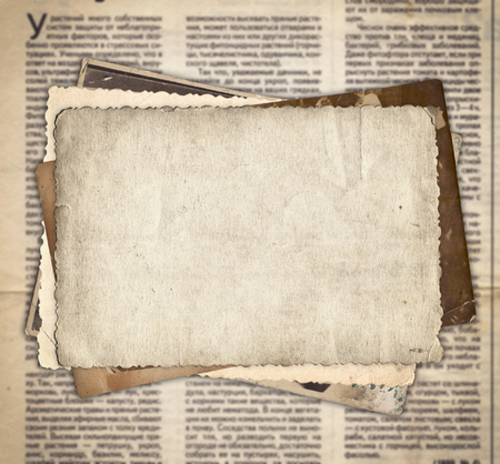 Vintage photos on the old newspaper texture background