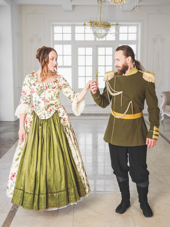 Beautiful couple man and woman in historical medieval costumes Archivio Fotografico