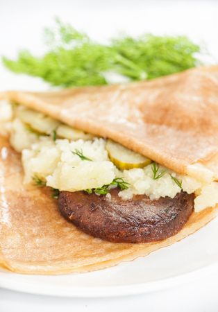 Thin delicious pancake with meat steak and mashed potatoes on white background Zdjęcie Seryjne