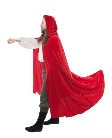 Handsome man in historical pirate costume and cloak holding something isolated on white