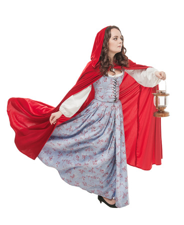 Beautiful woman in old historic medieval dress with lantern isolated