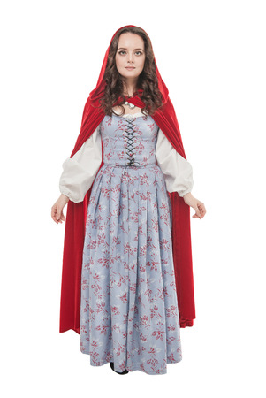Young beautiful woman in long medieval dress and red cloak isolated