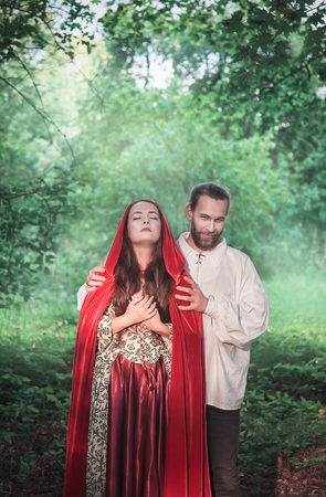 Beautiful couple man and woman in medieval costume outdoor Stock Photo