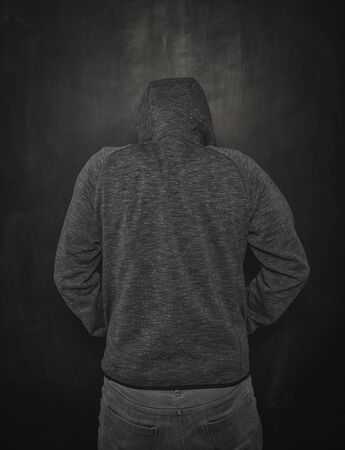Mystery unknown man in hood on dark background Reklamní fotografie