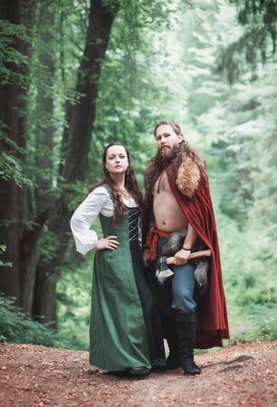 Brave Warrior Viking man with beautiful medieval woman standing outdoor Reklamní fotografie