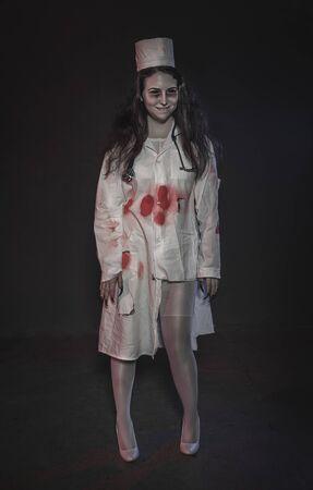 Terrible nurse woman smiling. Halloween horror scene
