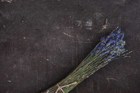 Beautiful dry lavender flowers on the rustic material background