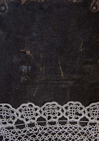 Old vintage lace fabric on the rustic material background