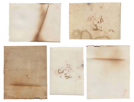 Bunch of Old vintage rough texture retro paper with burned edges, stains and scratches background