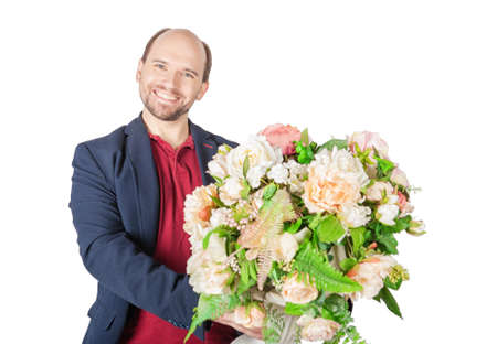Handsome man with beautiful bouquet of flowers for holiday isolated on white