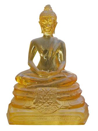 Buddha bright transparent yellow statue, Thai religion Buddha monk fetish. isolated Buddha statue with clipping path.