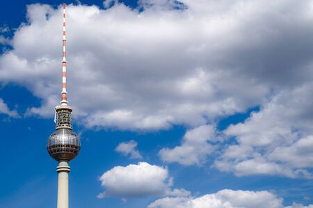 Berlin television tower top with white clouds