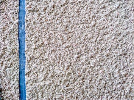 sandstone: sandstone surface tuxture and blue tab
