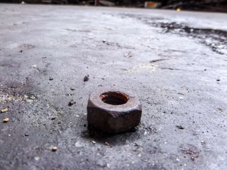 lighting technician: knot on dity garage floor Stock Photo