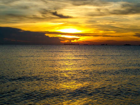 oversea: The last of sunlight when sunset in oversea light and shadow Stock Photo