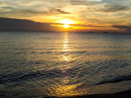 oversea: Eye of sunlight when sunset in oversea light and shadow
