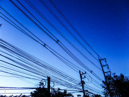 electric line: Electric line when sunset at country side at Banglmung city