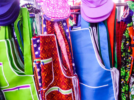 specific clothing: aprons and hats in local fresh food market Stock Photo