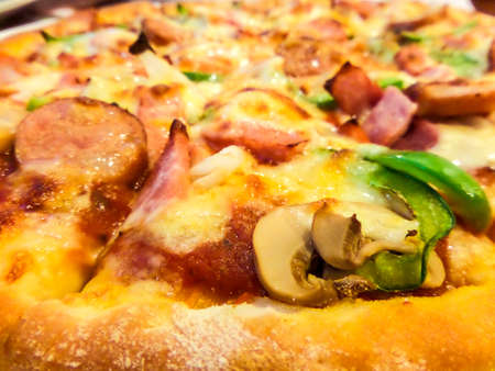 Pizza large size Supreme closeup is favorite fast food photo