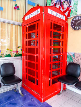 red telephone: Red telephone box in playground at school