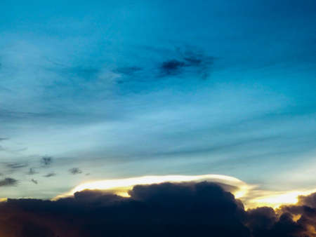 light complexion: Sunset and dark cloud in the sky