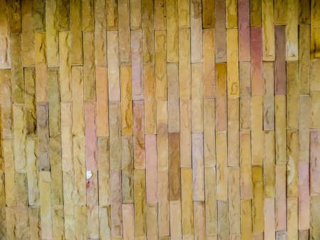 earth tone: Stone tile wall and earth tone color Stock Photo